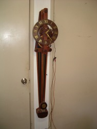 The same clock with some modifications including replacement of the weight with an electromagnet.