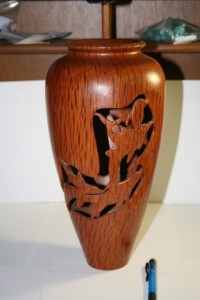 Vase. Has Dolphin carved features. Wall thickness 4mm to 5mm. Internal polishing to match external polishing. Turned from wet green timber. Sheoak.