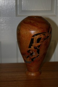 Vase with Dolphin features carved through the wall. Silky Oak.