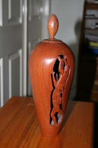 Vase. Carved AFL features with Aussie rules football. Jarrah.