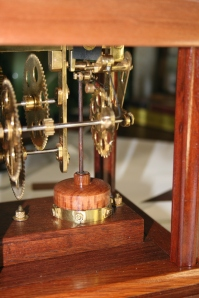Side view of the movement. The coil has been covered by a wooden bell and the magnet pops up and down.